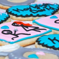 Cute engagement sugar cookies with simple stick figures and bright colors