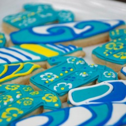 Surfing sugar cookies! Tropical Hawaiian shirts and surf boards.