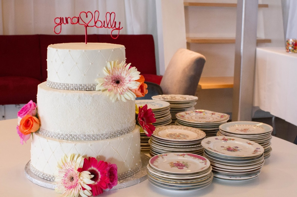3 tiers with different color cake inside for an ombre effect. Decorates with fresh flowers, sprinkles, dragees, and crystal ribbon.