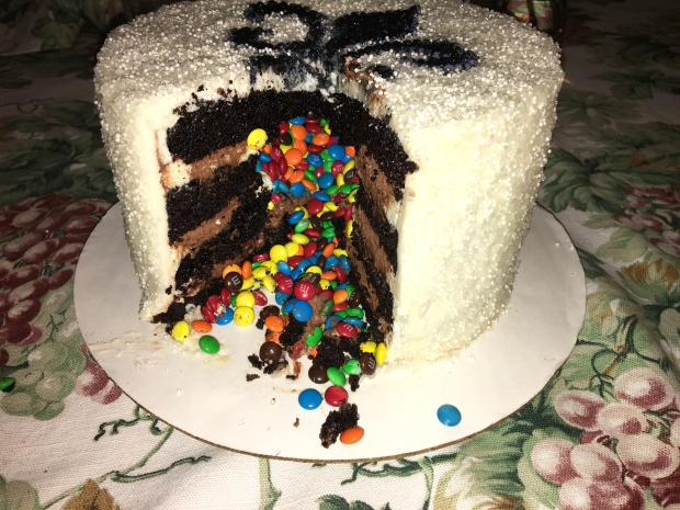 Fun chocolate non-traditional wedding cake with m&m's hidden inside.